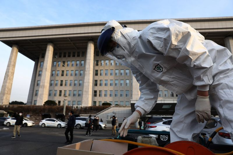 A disinfection professional wears protective gear at the National Assembly in Seoul on Feb. 24.