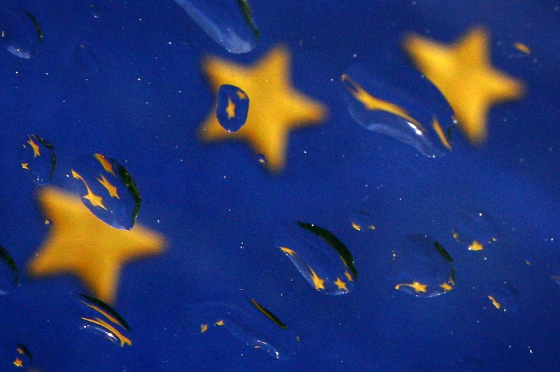 The European Union flag is seen through a windshield covered with raindrops in Sofia, Bulgaria on May 15, 2006.