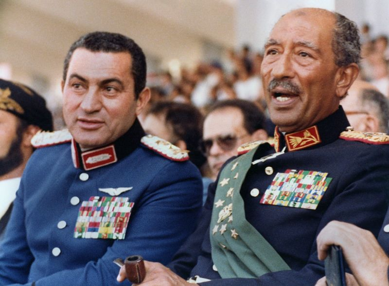 Then-Egyptian Vice President Hosni Mubarak (left) and President Anwar Sadat watch a military parade in Cairo moments before Sadat is assassinated on Oct. 6, 1981.