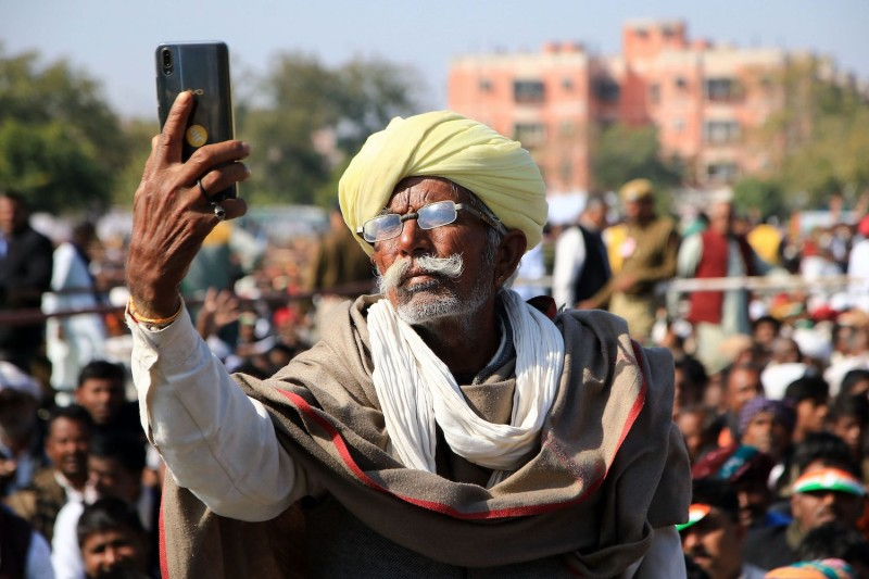 An Indian farmer takes a selfie on a smartphone in Jaipur on Jan. 9, 2019.