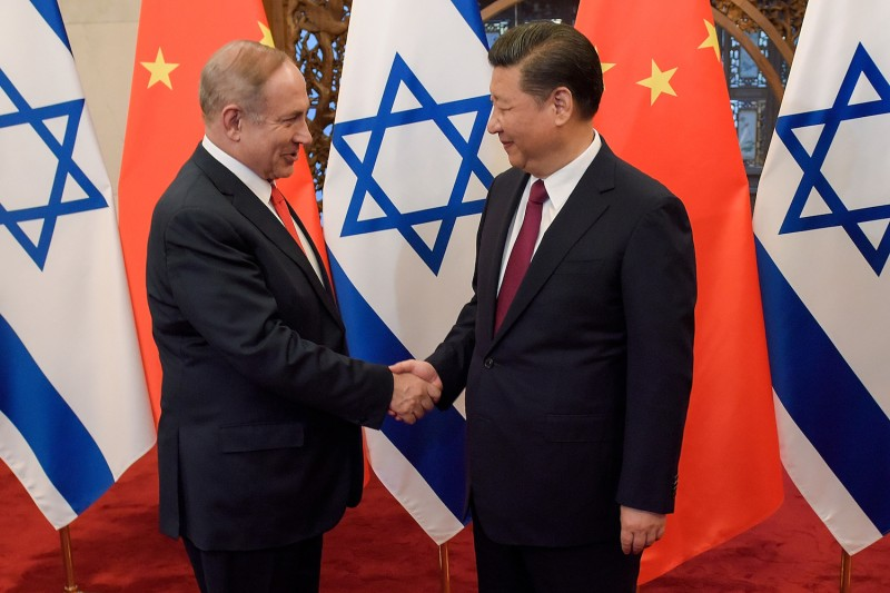 China's President Xi Jinping and Israel's Prime Minister Benjamin Netanyahu shake hands ahead of talks at the Diaoyutai State Guesthouse in Beijing on March 21, 2017.