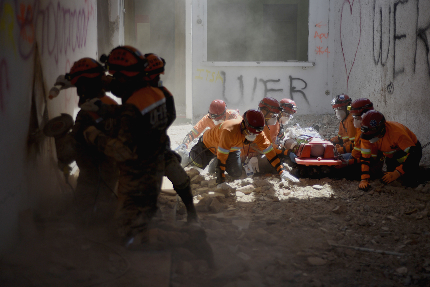 A group of rescuers take part in an earthquake drill in Guatemala City on Feb. 4. More than 360,000 people took part in the earthquake-evacuation drill in the Guatemalan capital, marking the anniversary of the 1976 earthquake that killed 23,000 people. JOHAN ORDONEZ/AFP via Getty Images