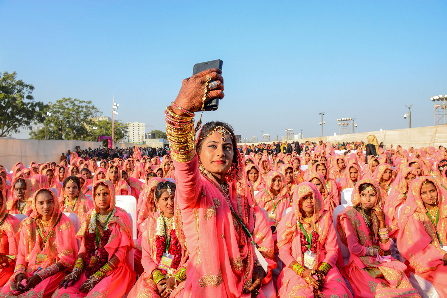 A Muslim bride takes a selfie with her cell phone as she participates in an All Religion Mass Wedding ceremony at Sabarmati Riverfront in Ahmedabad, India, on Feb. 8. SAM PANTHAKY/AFP via Getty Images