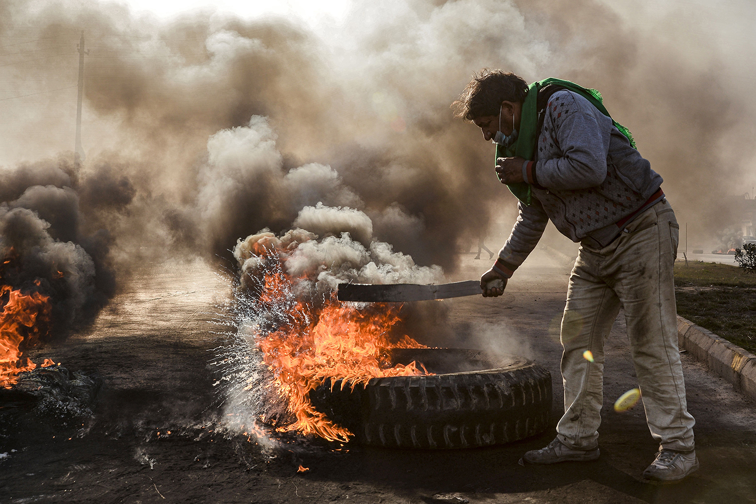 Anti-government protesters cut off a road with flaming tires during a demonstration against the new Iraqi prime minister designate in Najaf on Feb. 2. HAIDAR HAMDANI/AFP via Getty Images