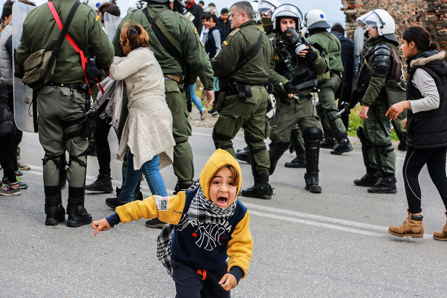 A young migrant reacts during clashes with riot police as refugees and migrants demonstrate outside the Kara Tepe camp, on the Greek island of Lesbos, on Feb. 3. MANOLIS LAGOUTARIS/AFP via Getty Images