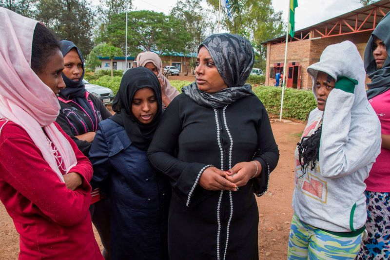 Asylum seekers evacuated from Libya gather at the Gashora Emergency Transit Center during a visit by permanent representatives of the African Union in Bugesera district, southeast of Rwanda's capital, Kigali, on Oct. 23, 2019.