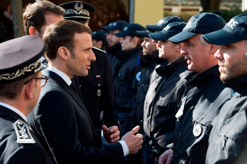 French President Emmanuel Macron meets police officers during a visit to Mulhouse, in eastern France, on Feb. 18.