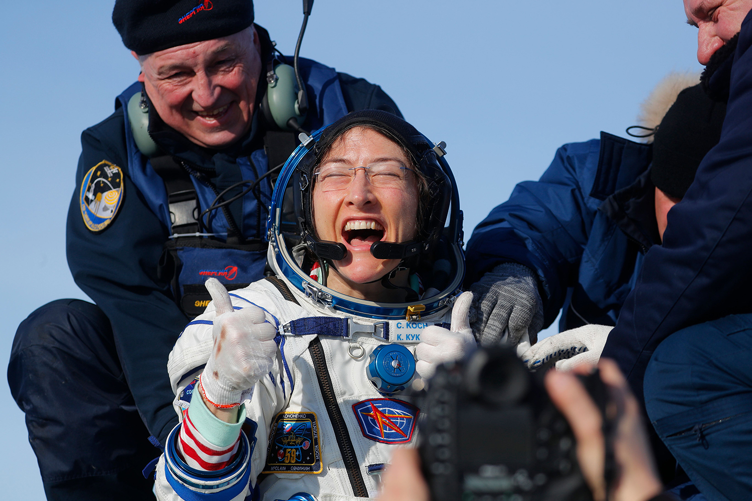 NASA astronaut Christina Koch reacts shortly after landing in a remote area outside the town of Dzhezkazgan, Kazakhstan, on Feb. 6. Koch returned to Earth safely having shattered the spaceflight record for female astronauts after almost a year aboard the International Space Station. SERGEI ILNITSKY/POOL/AFP via Getty Images
