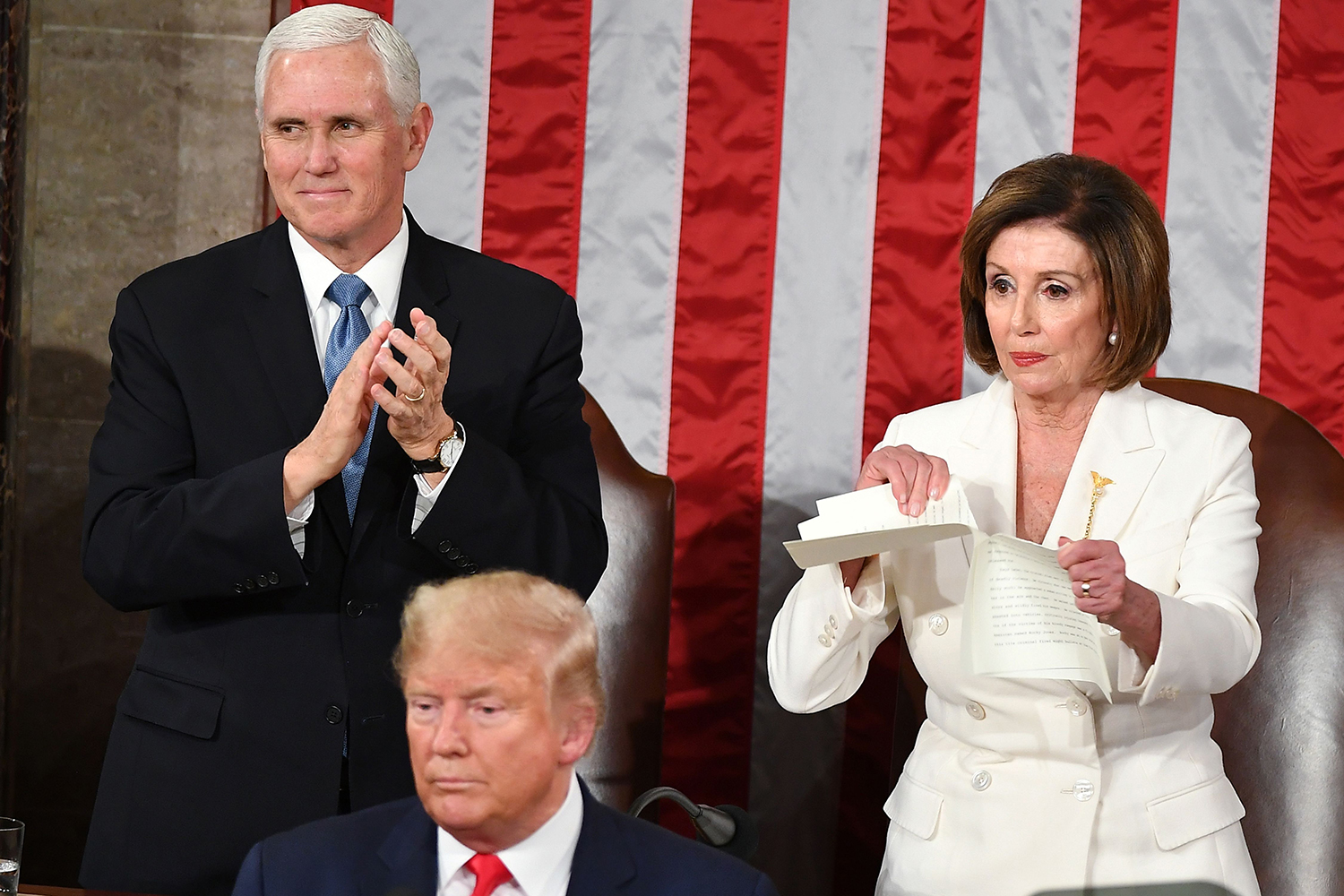 Speaker of the U.S. House of Representatives Nancy Pelosi rips a copy of U.S. President Donald Trump's speech after he delivered the State of the Union address at the Capitol in Washington on Feb. 4. MANDEL NGAN/AFP via Getty Images