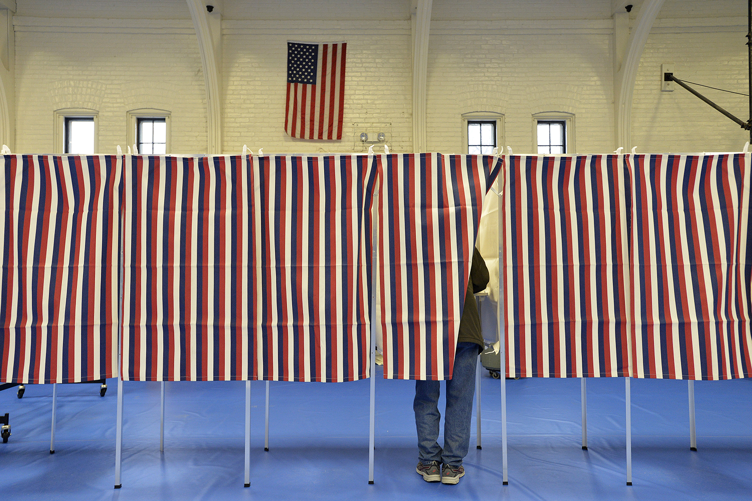 Voting booths fill a community center during the New Hampshire primary in Concord on Feb. 11. JOSEPH PREZIOSO/AFP via Getty Images