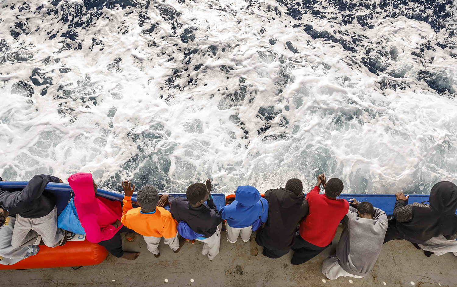 A group of migrants travel on board a rescue boat on Feb. 10, one day after their rescue off the Libyan coast. Ninety-three migrants from Mali, Ivory Coast, and Cameroon were rescued by the Spanish NGO Maydayterraneo in the central Mediterranean. PABLO GARCIA/AFP via Getty Images