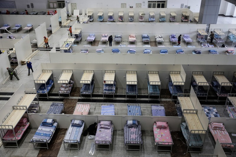 Workers prepare the Wuhan International Conference and Exhibition Center to serve as a temporary hospital for new coronavirus patients in Wuhan, China, on Feb. 4.