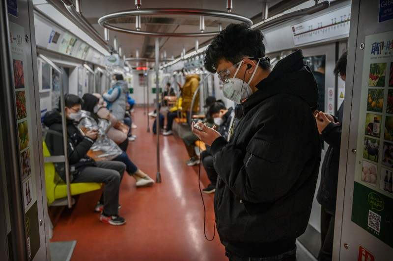 A man wears a protective mask as he stands on the subway during rush hour on Feb. 17 in Beijing.