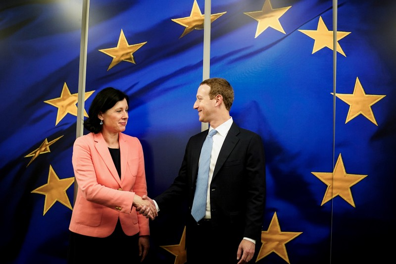 Vera Jourova, vice president of the European Commission  for values and transparency, shakes hands with Facebook CEO Mark Zuckerberg in Brussels on Feb. 17.