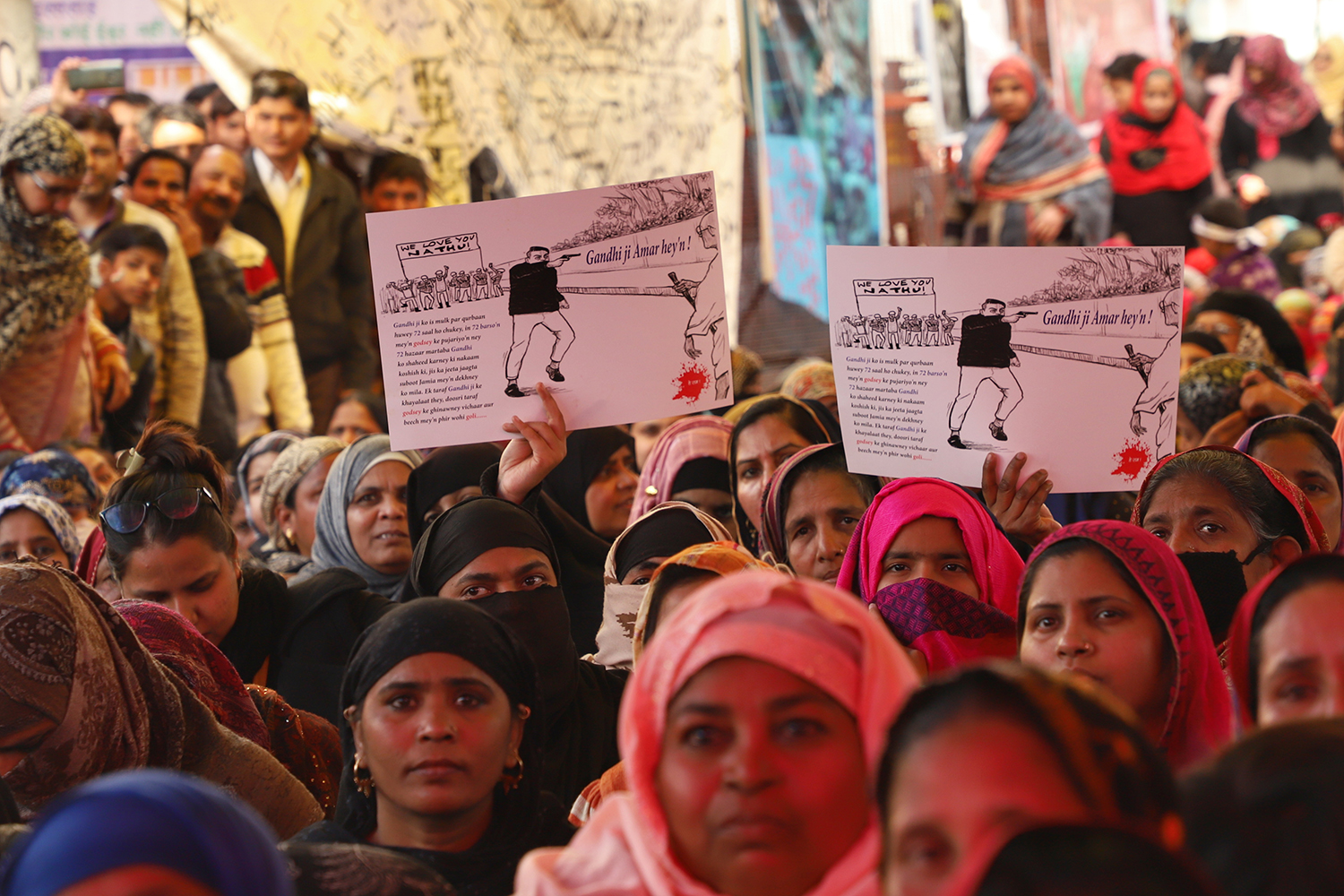 People take part in protests against the Citizenship Amendment Act and the National Register of Citizens at Shaheen Bagh in New Delhi, on Feb. 2, the day after a shooter fired on protesters there.