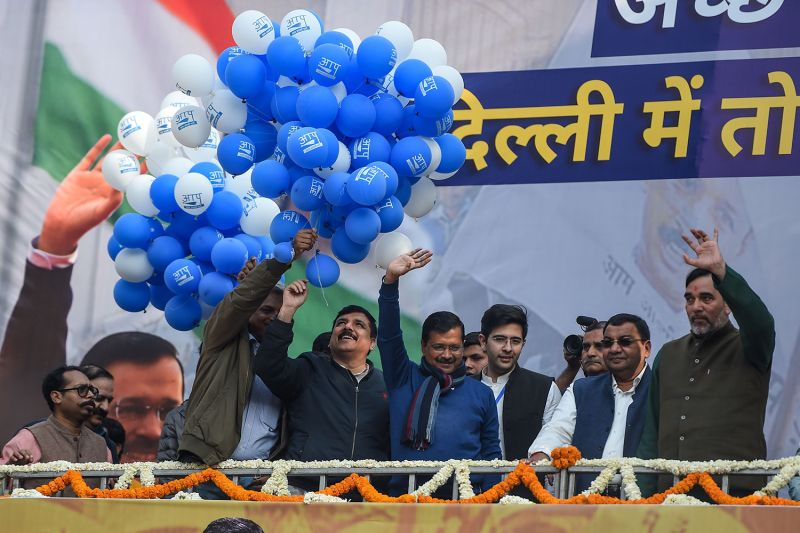 Aam Aadmi Party (AAP) chief Arvind Kejriwal gestures towards his supporters at the party headquarters in New Delhi on Feb. 11.