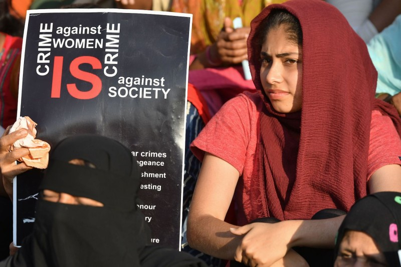 Muslim women hold placards during a protest rally held against India's new citizenship law.