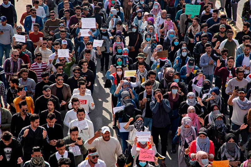 Iraqi students they march in an anti-government protest in the southern city of Basra, Iraq, on Feb. 6.