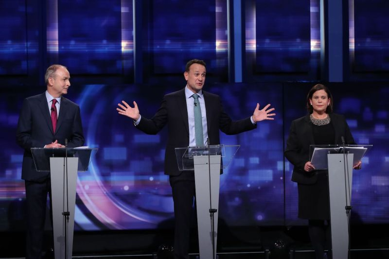 Fianna Fail leader Micheal Martin (left), Taoiseach and Fine Gael leader Leo Varadkar (center), and Sinn Fein leader Mary Lou McDonald take part in the final TV leaders' debate at the RTE studios.