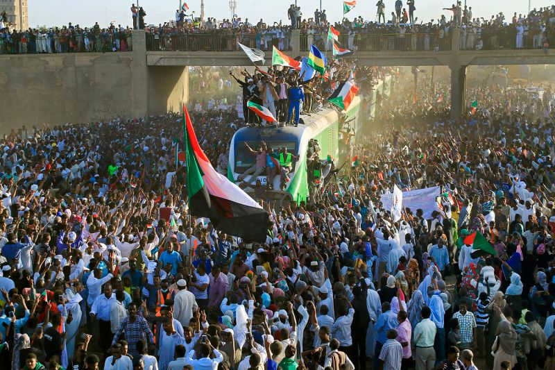 Sudanese protesters arrive to the town of Atbara from Khartoum on Dec. 19, 2019, to mark the first anniversary of the beginning of the uprising that toppled former President Omar al-Bashir.