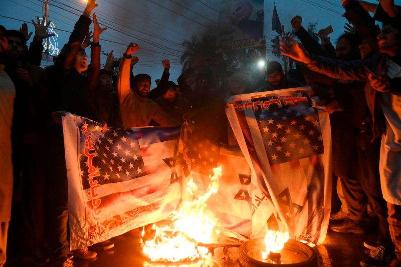 Pakistani Shiite Muslims in Lahore burn U.S. and Israeli flags in a protest against the killing of top Iranian commander Qassem Suleimani on Jan. 7.