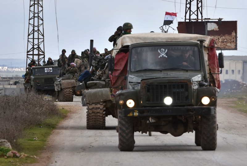 Syrian government forces deploy near the Damascus-Aleppo highway in Syria's Aleppo province on Feb. 10.