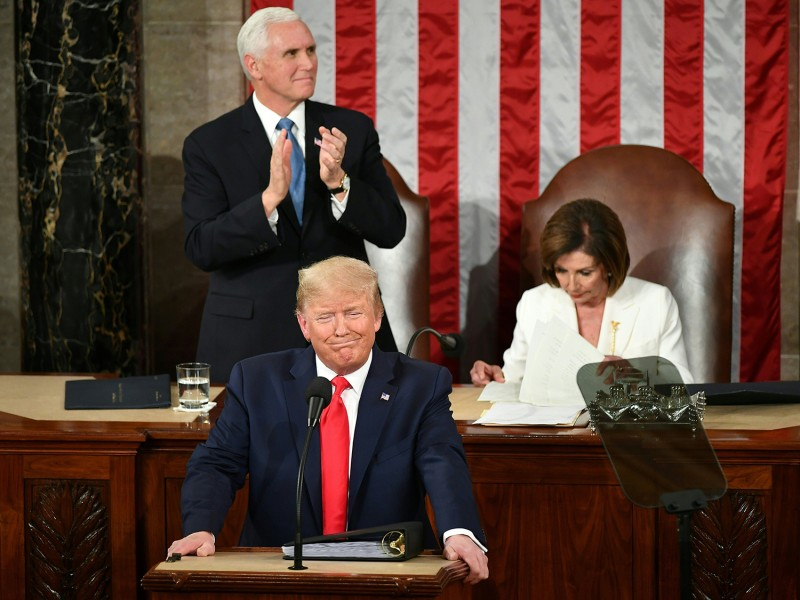 U.S. Vice President Mike Pence and Speaker of the House Nancy Pelosi welcome President Donald Trump as he arrives for his State of the Union address at the U.S. Capitol in Washington, on Feb. 4.