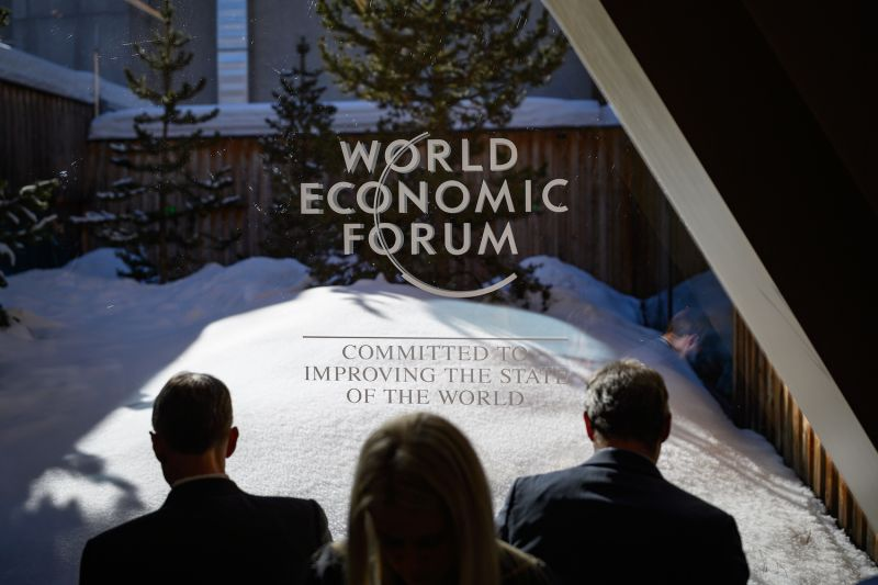 Participants check their messages on electronic devices during the World Economic Forum  annual meeting in Davos, Switzerland on Jan. 23.