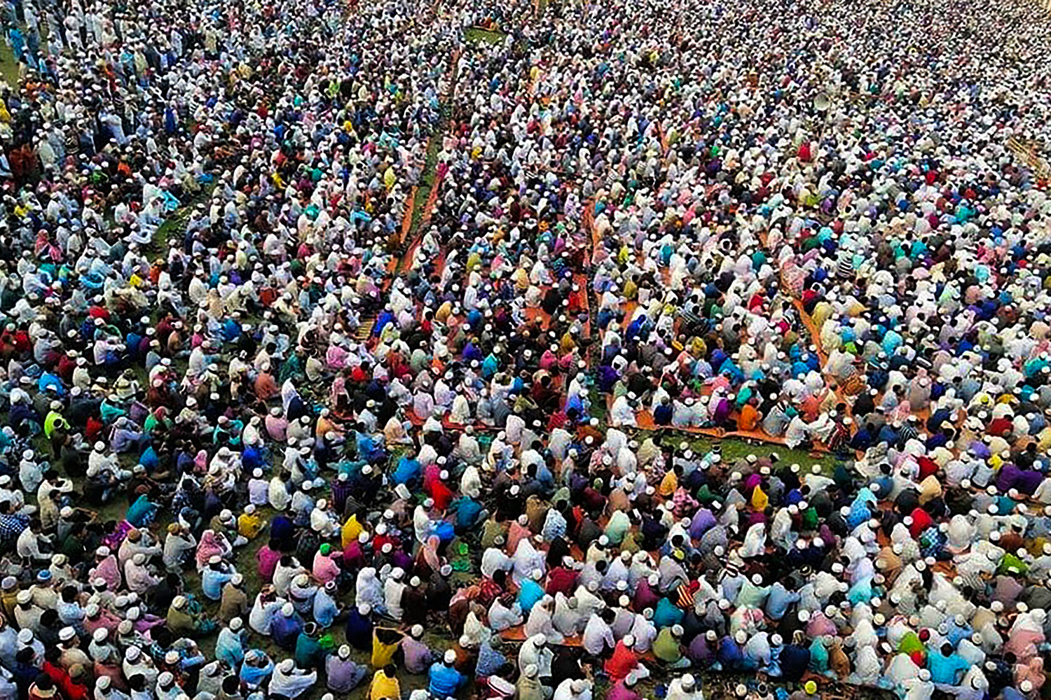 Thousands of Muslims attend a prayer session near Raipur in southern Bangladesh on March 18, asking for safety amid the spread of the coronavirus. STR/AFP via Getty Images