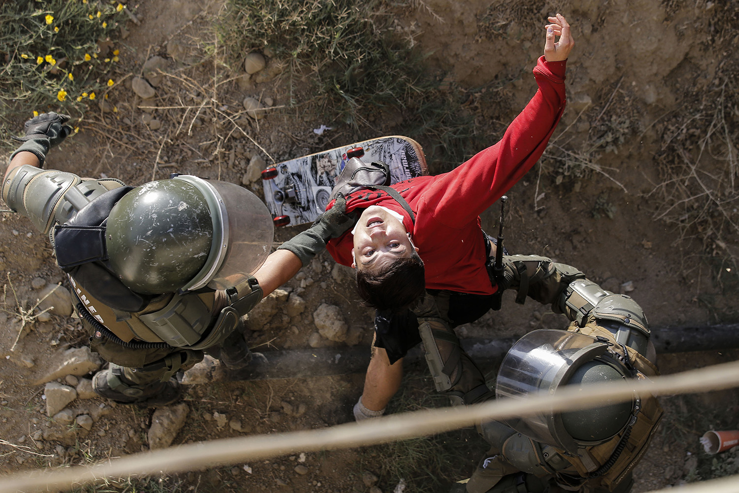 A demonstrator is detained by riot police during clashes that erupted in a protest against Chile's President Sebastian Pinera in the country's seaside resort of Vina del Mar on on Feb. 24. JAVIER TORRES/AFP via Getty Images