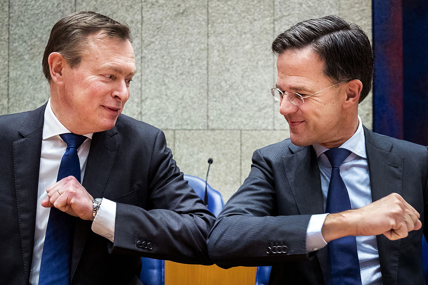 Dutch Prime Minister Mark Rutte (right) gives Dutch Minister for Medical Care Bruno Bruins an elbow bump—an alternative to a handshake during the coronavirus outbreak—at a meeting in The Hague, Netherlands, on March 10. REMKO DE WAAL/ANP/AFP via Getty Images