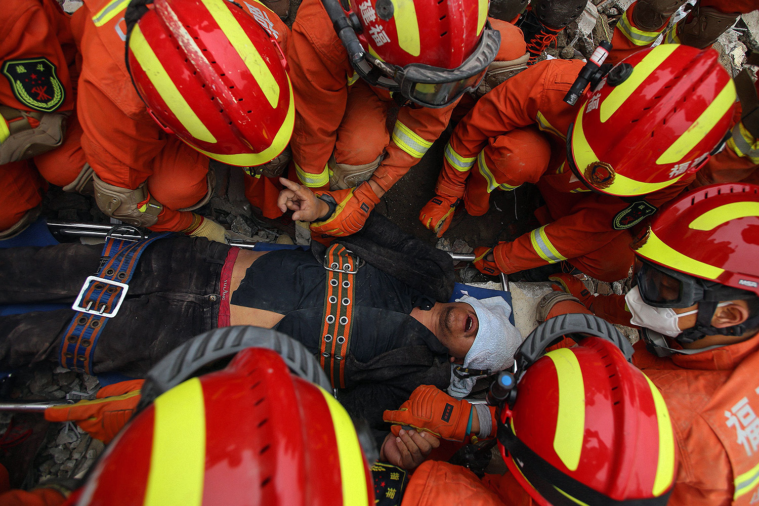 A man is rescued from the rubble of a collapsed hotel in Quanzhou, southeastern China, on March 8. The hotel had been a quarantine site for people exposed to the coronavirus. STR/AFP via Getty Images