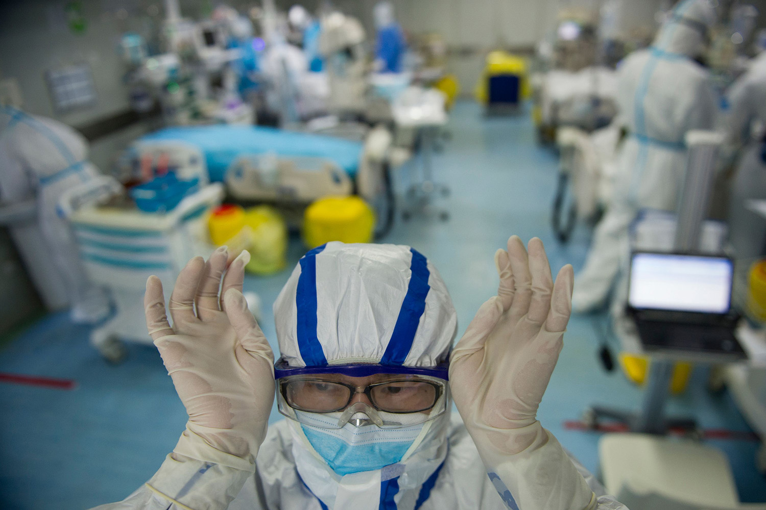 A nurse adjusts his goggles in an intensive care unit treating coronavirus patients at a hospital in Wuhan, China, on Feb. 26.. STR/AFP via Getty Images