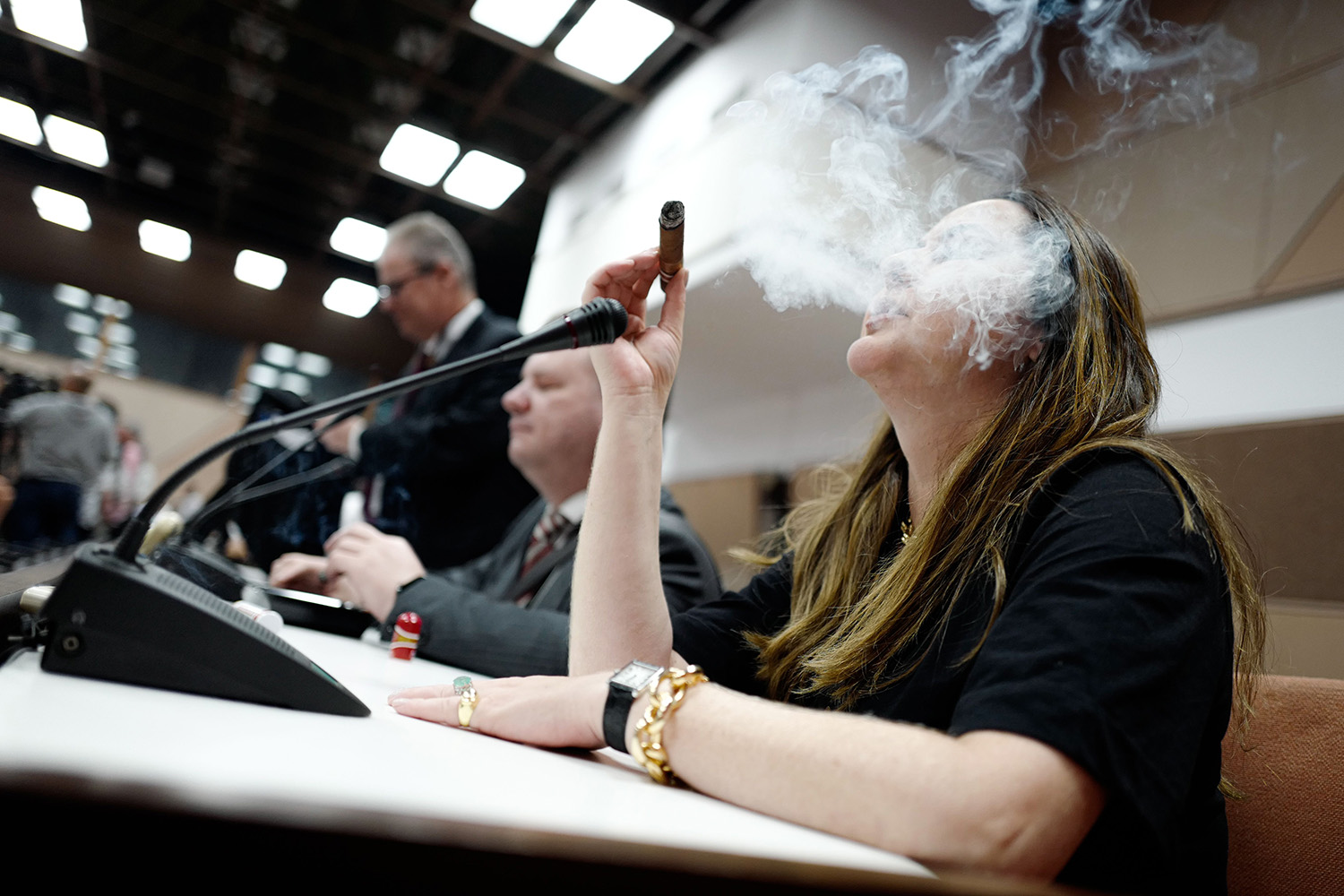 A woman smokes a cigar during the opening of the Cuban Cigar Festival at the Havana Convention Center on Feb. 24. ADALBERTO ROQUE/AFP via Getty Images