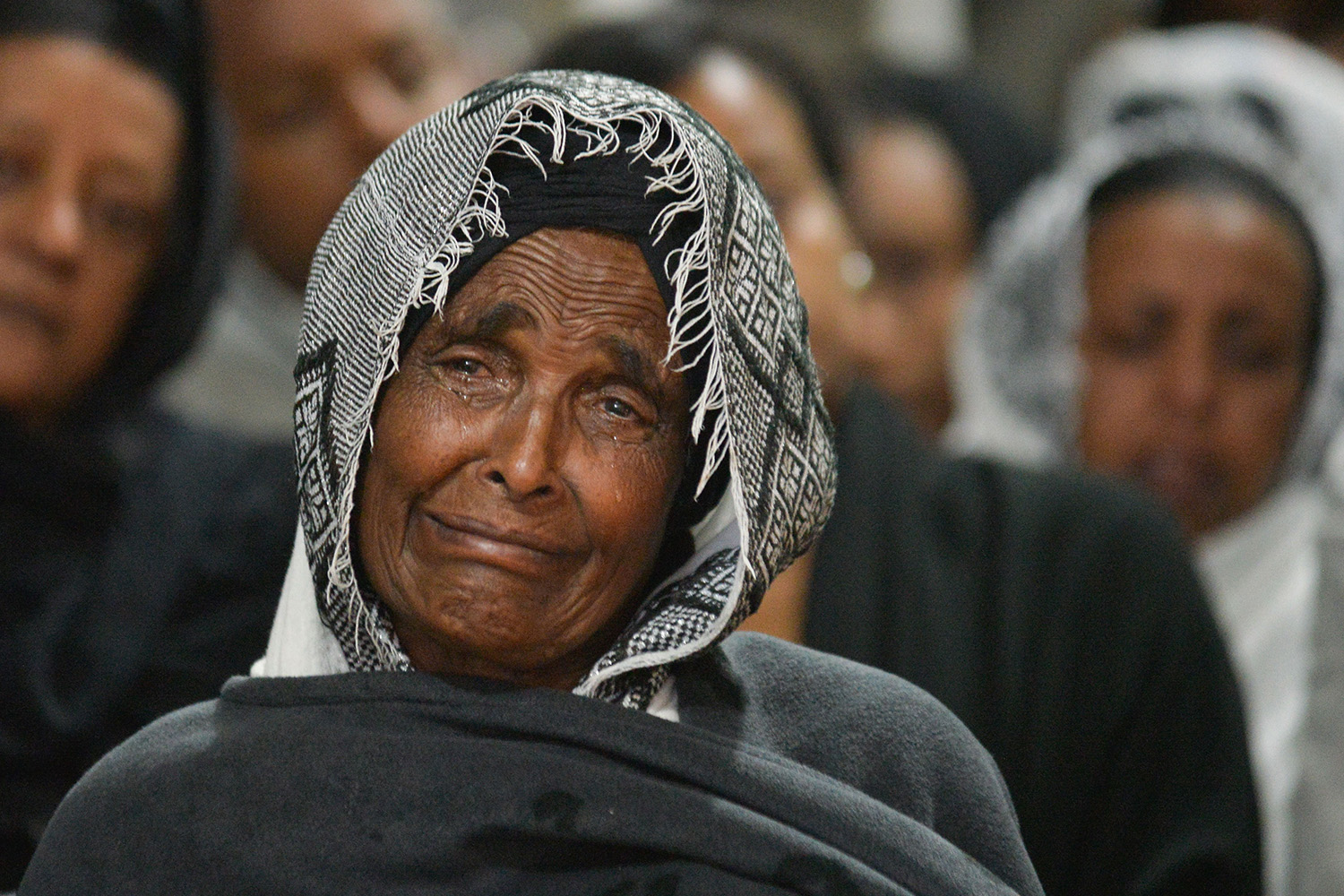 Family and friends of victims mourn at Holy Trinity Cathedral in Addis Ababa, Ethiopia, on March 8, two days before the one-year anniversary of the Ethiopian Airlines Flight 302 crash, which killed all 157 people on board in 2019. MICHAEL TEWELDE/AFP via Getty Images
