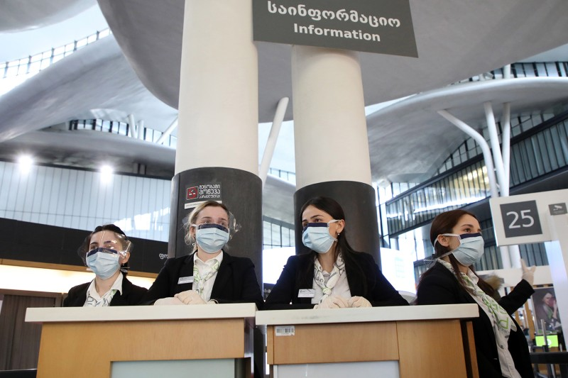 Employees in medical masks at the Tbilisi Public Service Hall as Georgia bans entry of foreign nationals to the country starting on March 18 to prevent the spread of the coronavirus.
