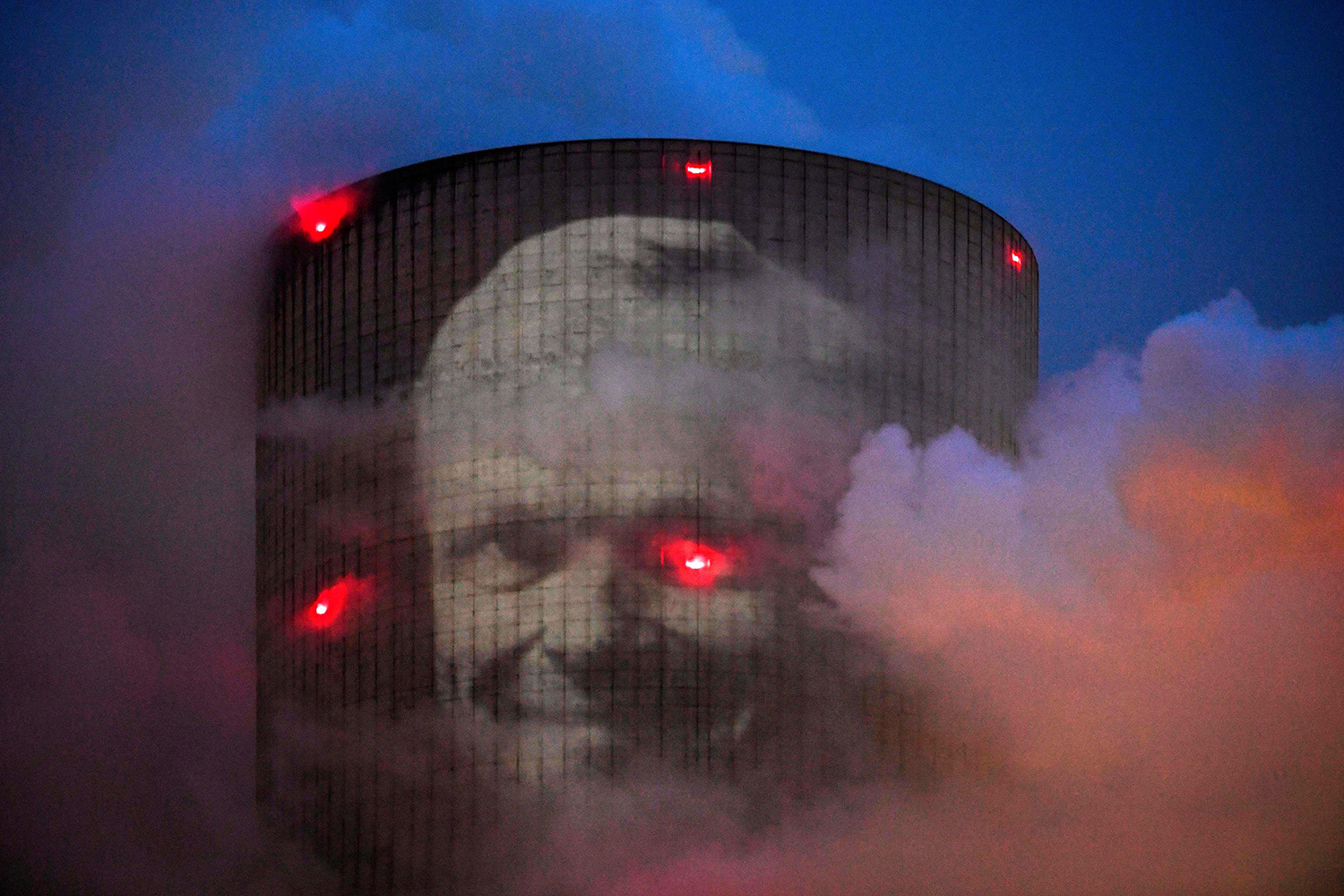 Greenpeace activists project an image of Pekka Lundmark, president and CEO of Finnish utility company Fortum, onto the cooling tower of the coal-fired power plant Datteln 4 of Uniper in Datteln, western Germany, on Feb. 26. INA FASSBENDER/AFP via Getty Images