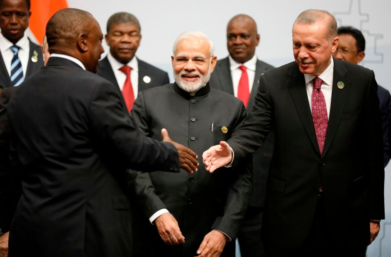 Turkey's President Recep Tayyip Erdogan and India's Prime Minister Narendra Modi are greeted by South Africa's President Cyril Ramaphosa