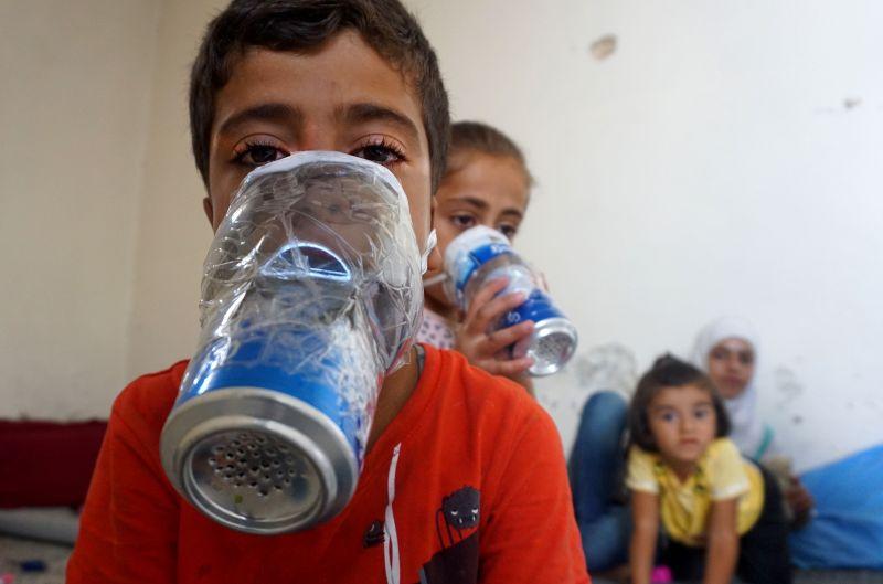 Syrian children try improvised gas masks