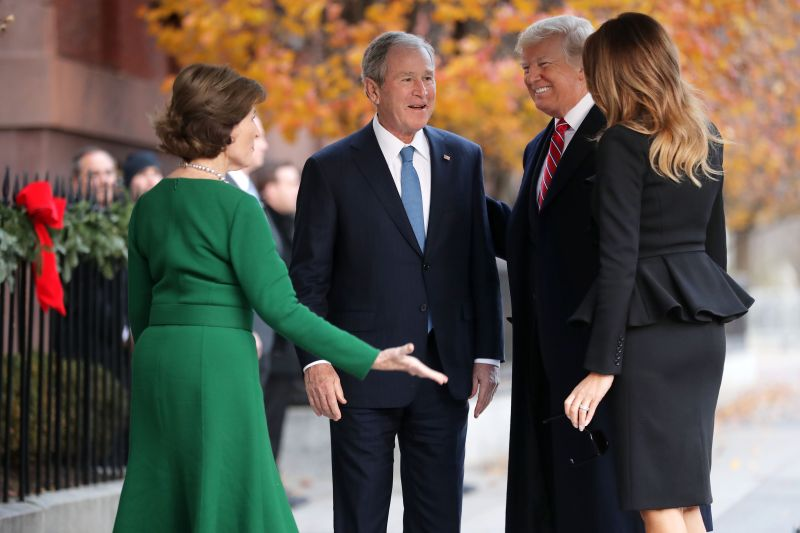 Former first lady Laura Bush and former President George W. Bush greet President Donald Trump and first lady Melania Trump