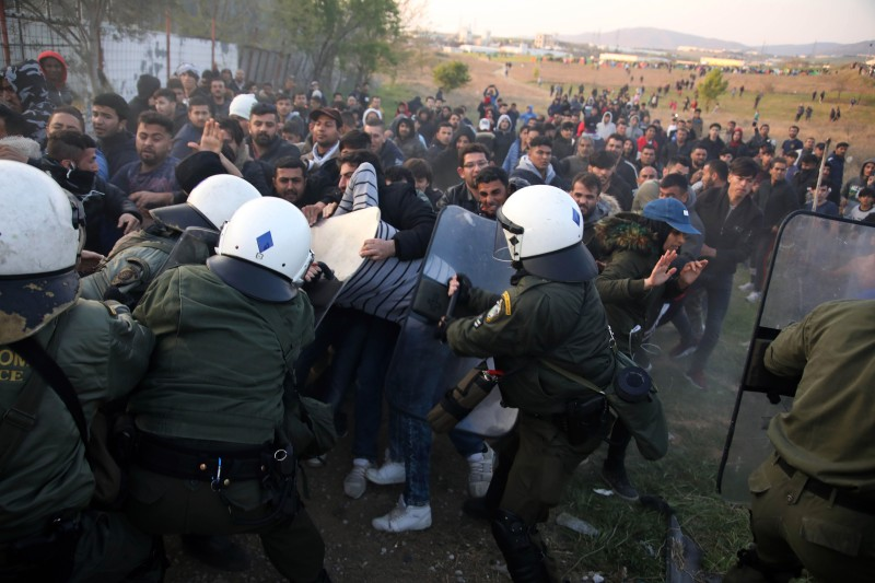 Riot police clashes with migrants outside of a refugee camp in Diavata, a west suburb of Thessaloniki on April 4, 2019.