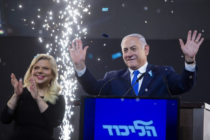 Israeli Prime Minster Benjamin Netanyahu and his wife, Sara Netanyahu, greet supporters following elections in Tel Aviv on April 10, 2019.