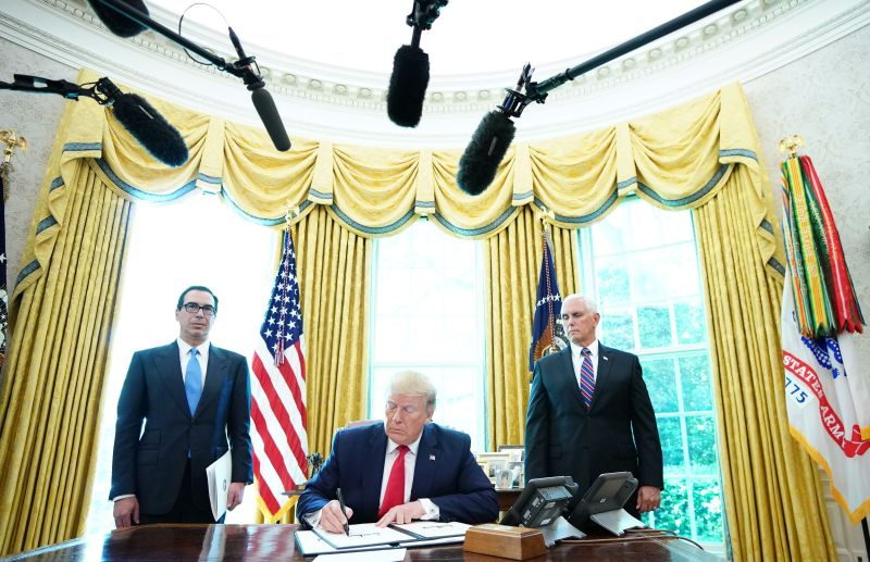 U.S. President Donald Trump signs new sanctions on Iran's supreme leader, Ayatollah Ali Khamenei, at the White House in Washington, DC, on  June 24, 2019.