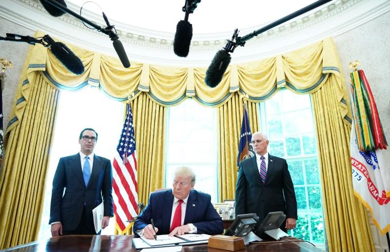 U.S. President Donald Trump signs new sanctions on Iran's supreme leader, Ayatollah Ali Khamenei, at the White House in Washington, DC, on  June 24, 2019.