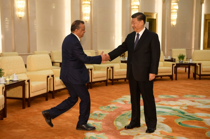 Tedros Adhanom Ghebreyesus, the director-general of the World Health Organization, left, shakes hands with Chinese President Xi Jinping