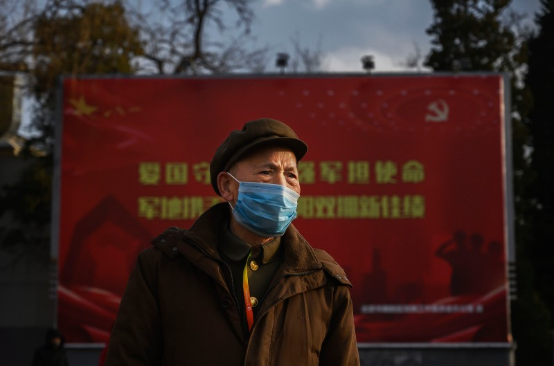 A Chinese man wears a protective mask