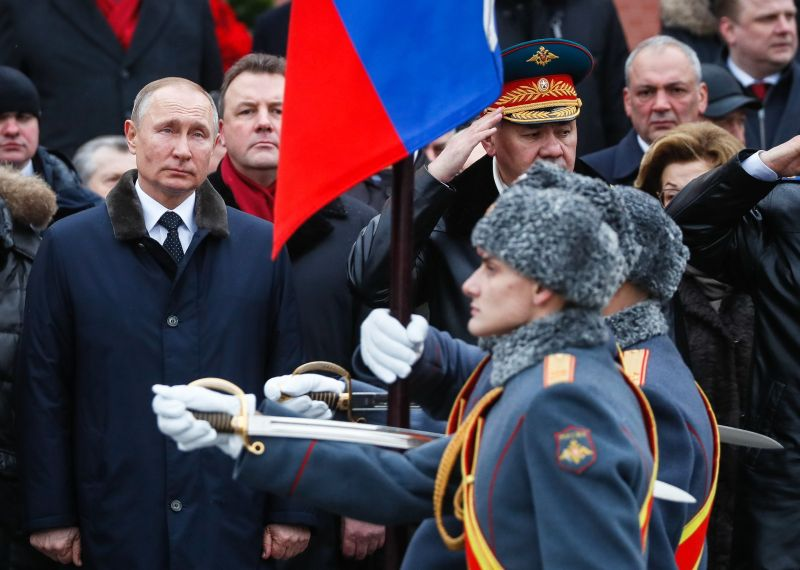 Russian President Vladimir Putin attends a wreath-laying ceremony at the Tomb of the Unknown Soldier by the Kremlin wall to mark the Defender of the Fatherland Day in Moscow on February 23, 2020. (YURI KOCHETKOV/POOL/AFP via Getty Images)