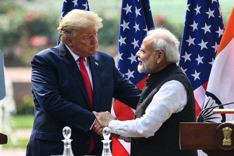U.S. President Donald Trump (left) shakes hands with India's Prime Minister Narendra Modi