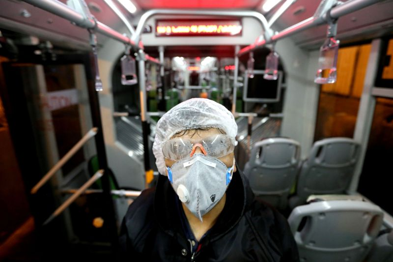 A worker cleans a bus to avoid the spread of the coronavirus in Tehran on Feb. 26.