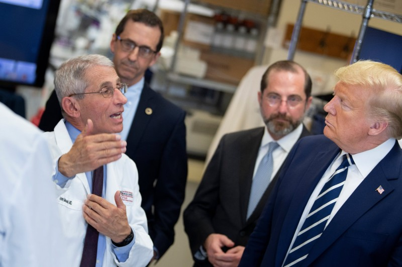 National Institute of Allergy and Infectious Diseases Director Anthony Fauci (left) speaks to U.S. President Donald Trump during a tour of the National Institutes of Health's Vaccine Research Center in Bethesda, Maryland, March 3.